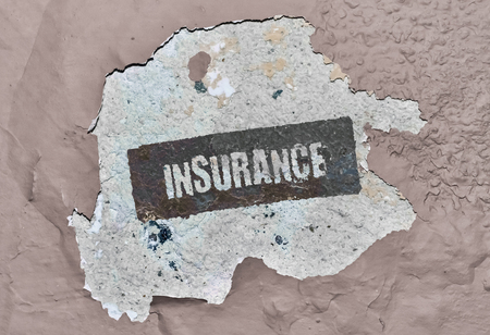 Word Insurance written on a damaged wall Imagens