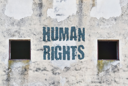 Text Human Rights written on the wall of an old jail