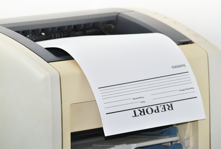 Closeup of a printer and a printed report in the office Stock Photo