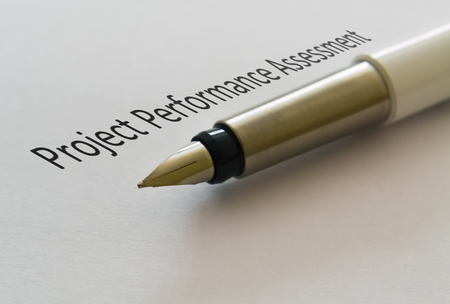 Text Project Performance Assessment and a fountain pen on bright background