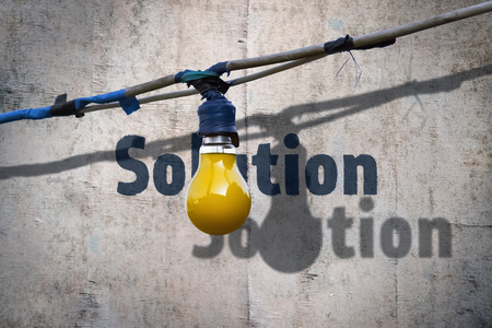 Yellow electric bulb and word Solution written under it Stock Photo