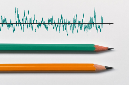 Two pencils and a real time graph on bright background
