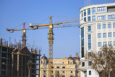 Construction site with crane and work on a new building in Skopje