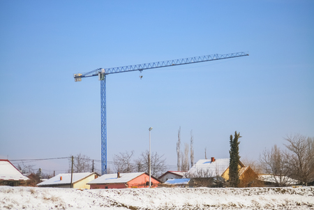Construction site with crane during the urbanization of rural area