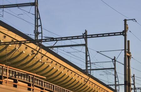 Detail of a modern train station with many interlaced electric cables