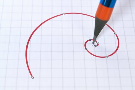 Pencil and a famous spiral drawn in red representing the golden ratio
