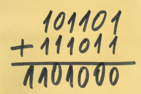 Example of a summation of two binary numbers on yellow background Stock Photo