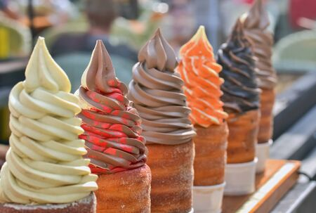 Detail of several types of ice cream offered on the street Stock Photo