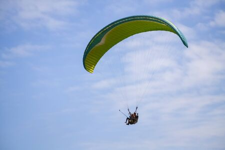Flight with a parachute and the sky in a windy summer day