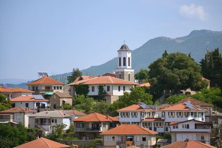 Mountain village and small Orthodox church in Macedonia Stock Photo