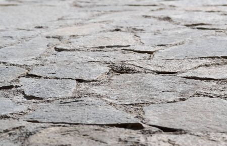 Detail of an old pavement seen from low perspective