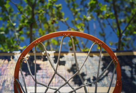 Detail of a basketball hoop on the playground viewed from below