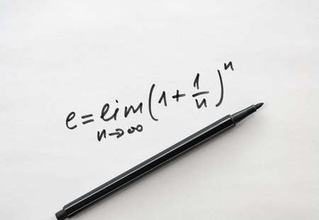 Definition of the number e as a limit of an array and a felt pen on bright background Stock Photo