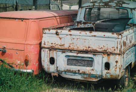 Detail of junkyard and disposal of old ruined cars ready for recycling Stock Photo