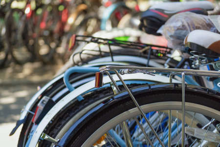 Detail of many carefully arranged bicycle in front of the shop Stock Photo