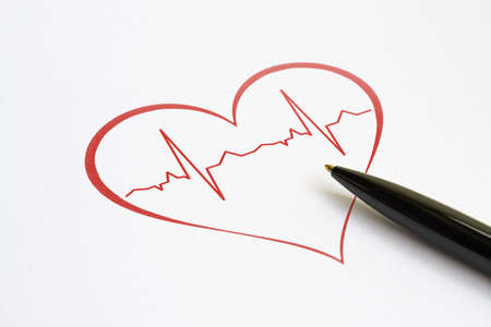 Red heart with stylized cardiogram and a pen on bright background Stock Photo