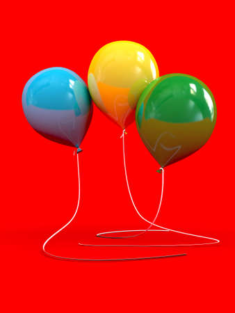 Three balloons isolated on red background