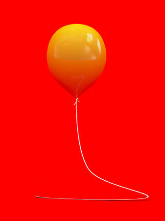 yellow balloon isolated on red background photo