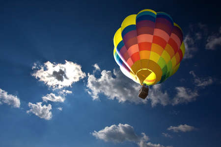 Hot air balloon in the blue sky and clouds Stock Photo