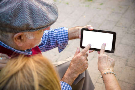 Hand senior man and woman using Cell phone