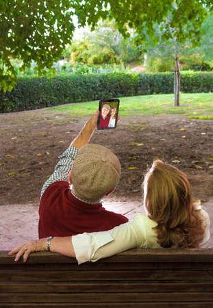 Senior man and senior woman doing a self-portrait Stock Photo
