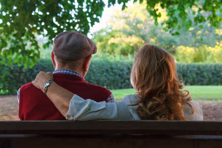 Senior couple sitting on a bench in Spain. 75 years old Stock Photo