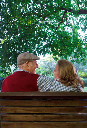 senior couple sitting on a bench in the park, Spain Stock Photo