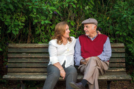 Senior couple sitting on a bench in Spain. They are 75 years old Stock Photo