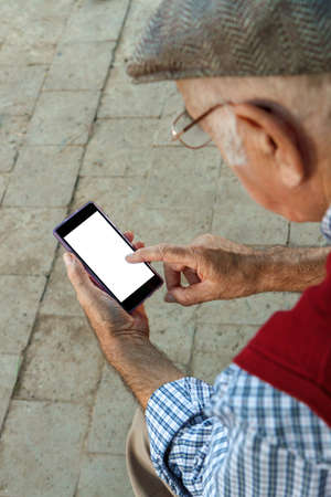 senior man using Cell phone. I is 75 years old