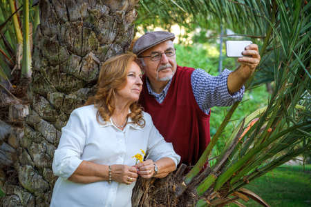 Senior couple doing a self-portrait. They are 75 years old