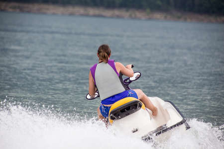 Young woman on a jet ski