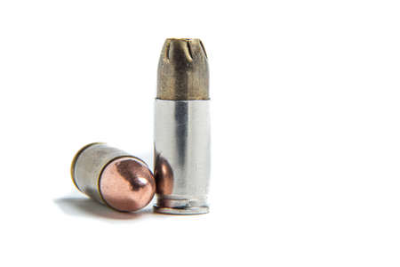 full metal jacket: 9mm jacketed hollow point cartridge compared to a 9mm full metal jacket 9x19 parabellum. Stock Photo
