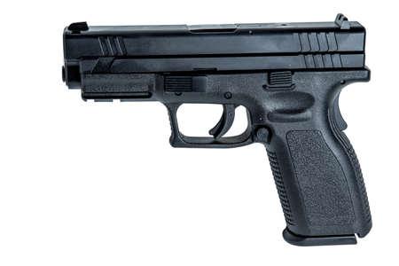 A 9mm semi-automatic handgun with a 17 round magizine. photo