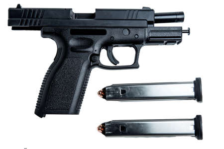semi automatic: A 9mm semi-automatic handgun with a 17 round magizine.