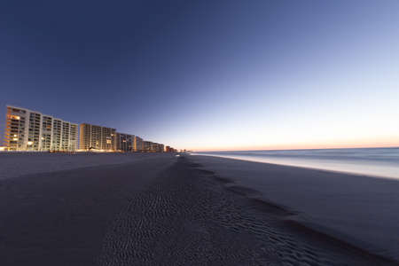 as far as the eye can see: Condos line one side of the beach, going as far as the eye can see. Stock Photo