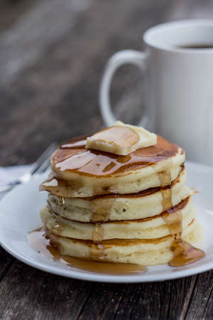 delicious pancakes on wooden table  and a cup of coffee.