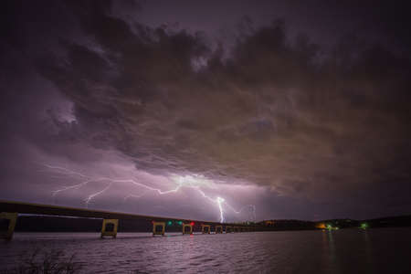 cloud to ground Lighting strikes near a bridge Stock fotó
