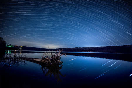 Shooting stars over the lake Stock Photo