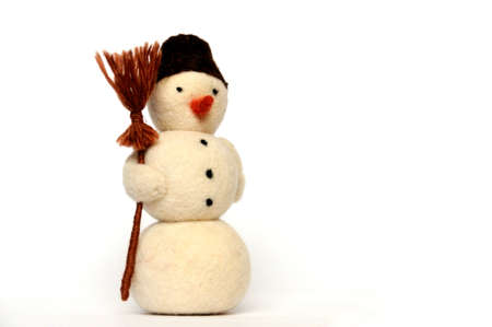 toy - a cheerful snowman with broom on white background, close-up photo