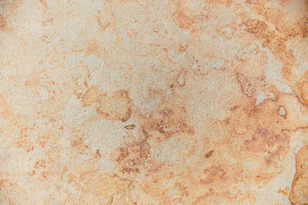 Background - texture of stone, a beautiful abstract pattern in beige and golden tones photo