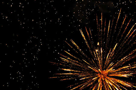 newyear night: Golden festive fireworks in colorful shades of yellow and orange Stock Photo