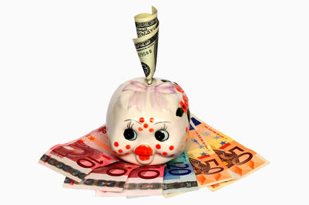 Piggy Bank with a hundred dollar bills in Slot against the euro Stock Photo - 11964690