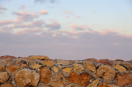 marmol: landscape, a stone wall and the sunset sky for background