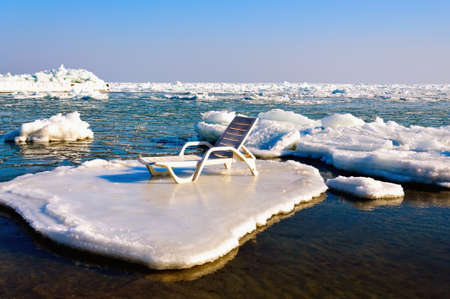 ice floes: Empty chaise lounge on the ice floe Stock Photo