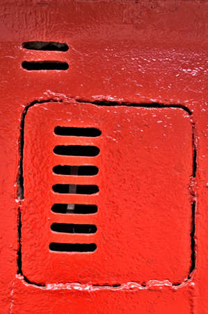 Old metal door with vents, painted with red paint Stock Photo - 13848469