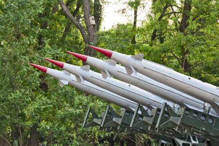 Rocket launchers against the background of green trees Stock Photo - 13848524