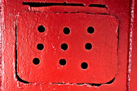 Red ventilating lattice with round holes Stock Photo - 13848525