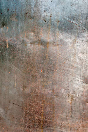 Background - an old patch from weathered stainless steel photo