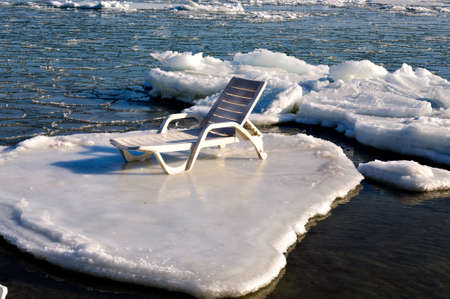 Empty chaise lounge on the ice floe photo