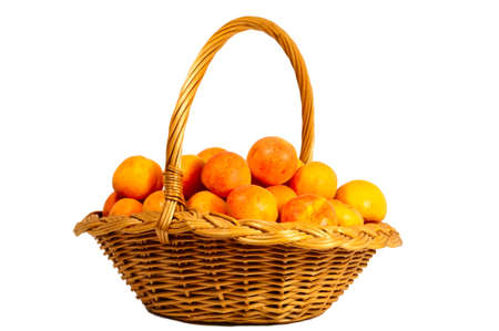 Basket with apricots, isolated on a white background.